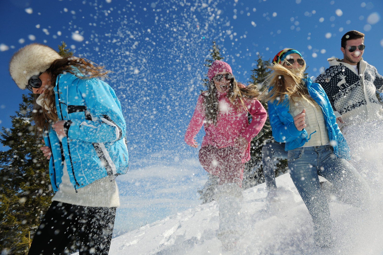 young people play in snow
