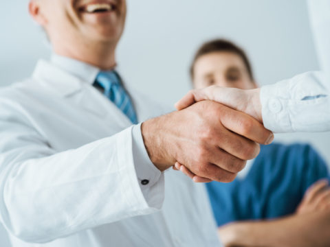Patient with health plan under Special Enrollment shakes hands with doctor