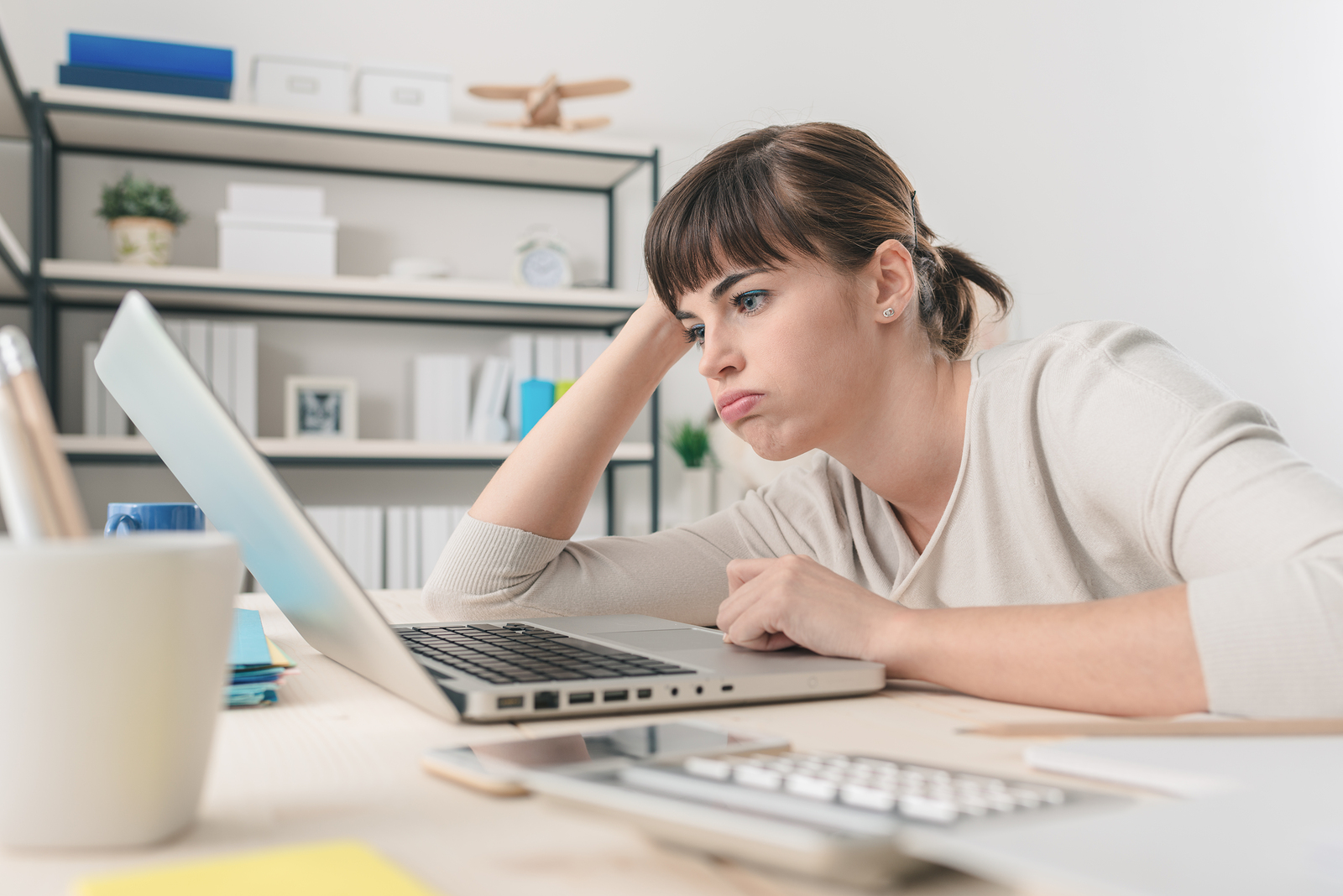 Flustered young woman learns about health insurance changes in 2017