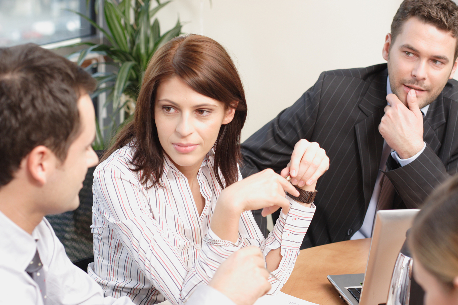 Young woman talks to colleagues at small business